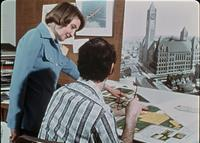 A student and faculty member reviewing a zoning map of Augsburg's campus, circa 1976