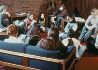 Students sitting in a lounge in the College Center (now Christensen Center), circa 1976