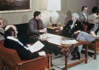 Faculty sitting in a lounge in the College Center (now Christensen Center), circa 1976