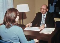 Advisor counseling a student, circa 1976