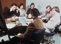 Students seated at a table during a discussion, circa 1976