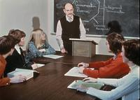 Dr. Raymond Anderson teaching as students listen, circa 1976