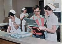 Unidentified nurses and a man at an unidentified medical center, circa 1976