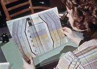 An Augsburg student inspects a Riasec coding sheet, circa 1976