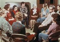 A group of Augsburg students seated with others in a circle, circa 1976