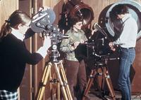 Students working with film cameras in an unidentified studio, circa 1976.