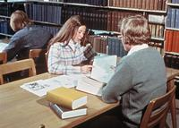 Two students studying in Sverdrup Library (now Sverdrup Hall), circa 1976