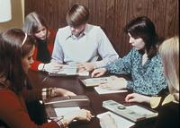A study group practicing speed reading using reading pacers, circa 1976.