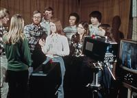 Students discussing in a television studio, circa 1976