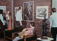 Students looking at artwork in the College Center (now Christensen Center), circa 1976