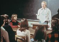 An Augsburg student presents to peers during class, circa 1976