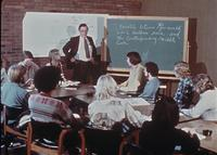 Dr. Carl Chrislock teaching students in a classroom, circa 1976