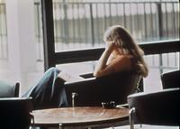 A student sitting in the lounge area of Mortensen Hall, circa 1976