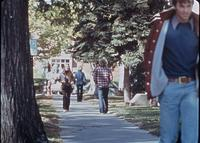 Students walking along South Seventh and 1/2 Street, opposite Murphy Square, circa 1976