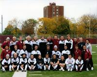 Augsburg men's soccer team poses at Edor Nelson Field with Urness Tower and Murphy Square in the background, circa 2007.