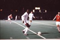 An Augsburg men's soccer player passes the ball, 1996.