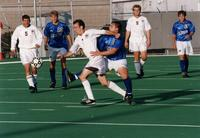 Men's Soccer Player gets away from an opponent, undated.