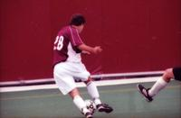 An Augsburg men's soccer player dribbles, 2000.