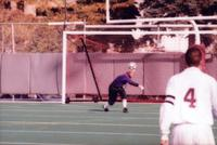 Augsburg men's soccer goalkeeper punches the ball, 1997.