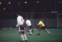 An Augsburg men's soccer player dribbles in the midfield, 1996.