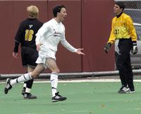 An Augsburg men's soccer player celebrates a goal playing against Gustavus Adolphus, 2002.