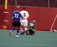 The Augsburg men's Goalkeeper comes up to grab the ball in a game against St. Scholastica, 2003.