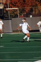 An Augsburg men's soccer player chests the ball, 1999.