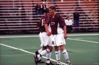 Three Augsburg men's soccer players stand in a wall, 2000.