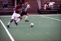 Gibran Lorenzano runs past a defender, 2000.