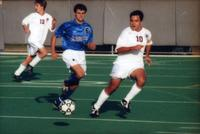 Carlos Martinez runs with the ball in the midfield, 1999.