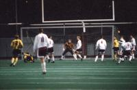 The Augsburg men soccer players defend their goal, 1995.