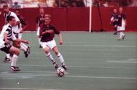 An Augsburg men's soccer player passes the ball, 2000.