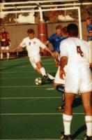 An Augsburg men's soccer player takes a shot, 1999.
