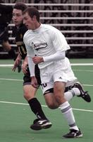 Mike Elcano sprints forward against Gustavus Adolphus, 2002.