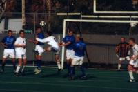 The Augsburg men's soccer team attack a corner, 1999.