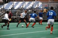 Auggies men's soccer midfielder passes forward, 1998.
