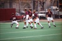 Five Augsburg men's soccer players defend a free kick, 2000.