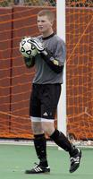 An Augsburg's men's soccer goalkeeper holds the ball playing against Gustavus Adolphus, 2002.