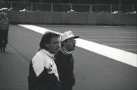 Augsburg men's soccer coaches looks at their players, 1993.