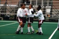 Four Augsburg's men soccer players celebrate a goal, 1995.