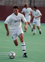 Jason Clark dribbles forward in a game against St. Scholastica, 2003.