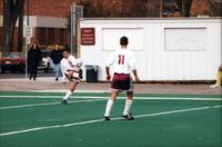 An Augsburg men's soccer player kicks the ball, 1995.