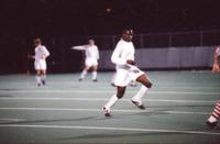 An Augsburg men's soccer player runs after the ball, 1996.