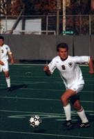 Eric Roy looks at his teammates as he takes the ball forward, 1999.