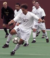 Matt Lachner holds the ball playing against Gustavus Adolphus, 2002.