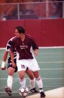 Matt Lachner holds the ball with an opponent behind him, 2000.
