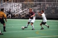 Aaron Sharratt turns his body with the ball, 2000.