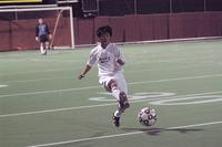 An Augsburg men's soccer player passes the ball in a game against St. Thomas, 2003.