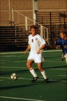 An Augsburg men's soccer player tries to hold the ball, 1999.