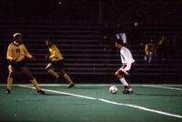 An Augsburg men's soccer player dribbles, 1994.
